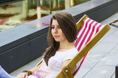 Beautiful brunette at summer beach Royalty Free Stock Image