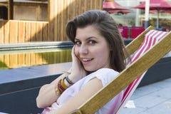 Beautiful brunette at summer beach Stock Images