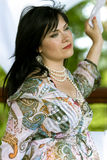 Beautiful brunette in summer garden Stock Photography