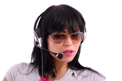 Beautiful brunette with sunglasses and headphone Stock Images