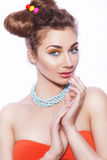 Beautiful brunette sweet woman with colorful make up and nail po. Lish, and cute bun hairstyle. white background Stock Photography