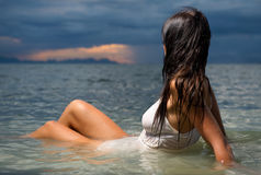 Beautiful brunette swimming Royalty Free Stock Image