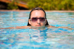 Beautiful brunette at the swimming pool Stock Photography