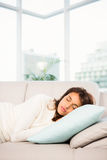 Beautiful brunette taking a nap lying on the couch Royalty Free Stock Photo
