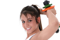 Beautiful Brunette Teen with Hand Weights Royalty Free Stock Photography