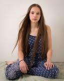 Beautiful Brunette Teenage Girl In Blue Pajamas stock image