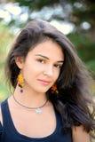 Beautiful brunette teenage girl outside Stock Images