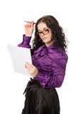 Beautiful brunette thinking woman holding notebook and pen Stock Photo