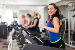 Beautiful brunette on a treadmill Royalty Free Stock Image