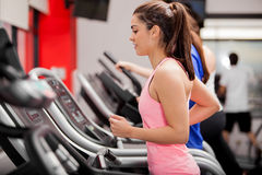 Beautiful brunette on a treadmill Stock Image