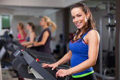 Beautiful brunette on a treadmill Royalty Free Stock Photos