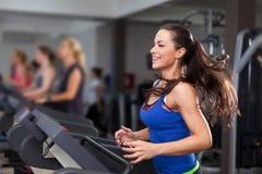 Beautiful brunette on a treadmill Stock Photo