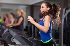 Beautiful brunette on a treadmill Royalty Free Stock Images