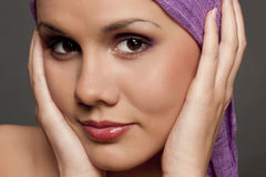 Beautiful brunette in a violet scarf Royalty Free Stock Image