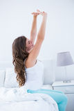 Beautiful brunette waking up Stock Photography