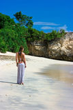 Beautiful brunette walking on beach Stock Photography