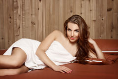 Beautiful brunette on a water bed Royalty Free Stock Photos