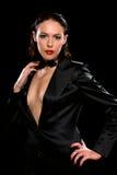 Beautiful brunette wearing a black suit Stock Photos