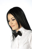 Beautiful brunette wearing a black tie bow Royalty Free Stock Photography