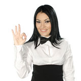 Beautiful brunette wearing a black tie bow and showing ok sign Stock Photos