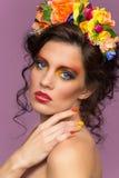 Beautiful brunette wearing flower headband Royalty Free Stock Photos