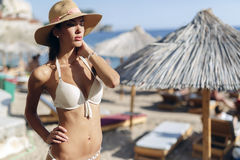 Beautiful brunette wearing hat on beach Royalty Free Stock Photos