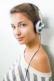 Beautiful brunette wearing headphones. Stock Images