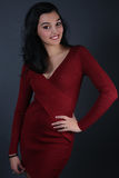 Beautiful brunette wearing a red dress Royalty Free Stock Photography