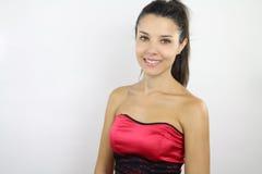 Beautiful brunette wearing a red dress Stock Photo