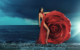 Beautiful brunette wearing rose dress. Beautiful brunette wearing red rose dress Royalty Free Stock Photography