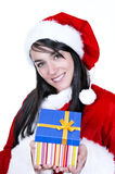 Beautiful brunette wearing santa claus with gift Stock Photo