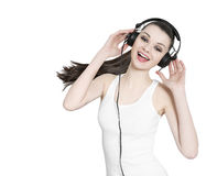 Beautiful brunette weoman with headphones dancing to music. On white background stock images
