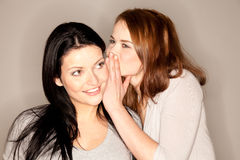 Beautiful brunette whispering Stock Images