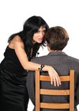 Beautiful brunette whispers on  ear  man Royalty Free Stock Image