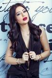Beautiful brunette on a white background. Fashion model posing at studio royalty free stock image