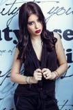 Beautiful brunette on a white background. Fashion model posing at studio stock photos