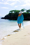 Beautiful brunette with white hat on beach Royalty Free Stock Photos