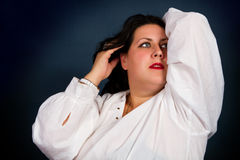Beautiful brunette in a white shirt Stock Photos