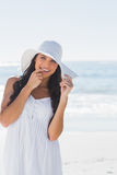 Beautiful brunette in white sunhat looking at camera Royalty Free Stock Images