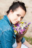 Beautiful brunette with wildflowers Royalty Free Stock Photography