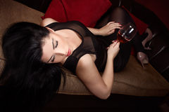Beautiful brunette in a wine bar Royalty Free Stock Images