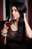 Beautiful brunette in a wine bar Stock Image