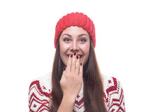 Beautiful brunette in winter clothes. Lovely beautiful brunette in winter clothes covers her mouth. Isolated on white background Royalty Free Stock Photography