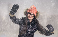 Brunette in snowstorm Royalty Free Stock Photography