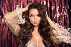 Free Beautiful Brunette With Healthy Wavy Hair. Beauty Makeup. Fashion Girl In Glamour Dress With Feather Sleeves Isolated On Bright Stock Image - 163941281