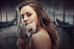 Beautiful Brunette With Venetian Mask. Young And Beautiful Woman On Venetian View Background, Gondolas. Stock Image