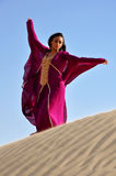 Beautiful brunette woman in arabic desert Stock Images