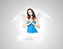 Beautiful brunette woman as angel. With wings Royalty Free Stock Image