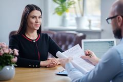 Beautiful brunette woman attending job interview. Beautiful brunette women attending job interview stock images