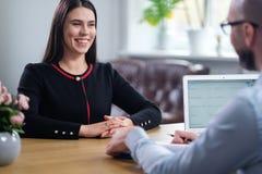 Beautiful brunette woman attending job interview. Beautiful brunette women attending job interview stock photos